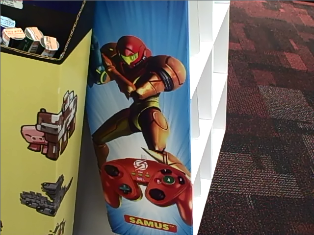 File:Wired Fight Pad Samus GameStop display.png