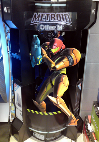 File:MOM standee.png