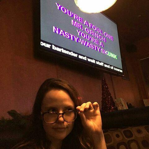 File:Sarah taking off glasses.jpg