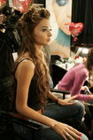 52152000-model-gets-her-hair-done-backstage-at-the-gettyimages