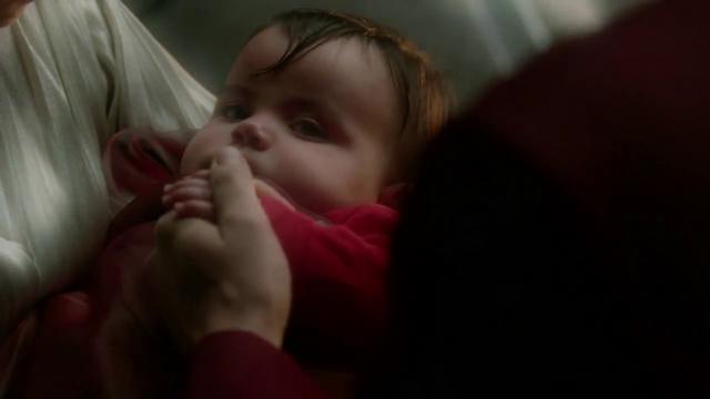 File:Baby Kal-El being held by his parents.png