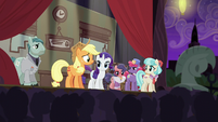 Applejack on stage talking to the audience S5E16