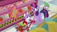 Twilight Sparkle picking up toys off the shelf S7E3