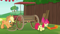 Apple Bloom drags car spoiler across the grass S6E14.png