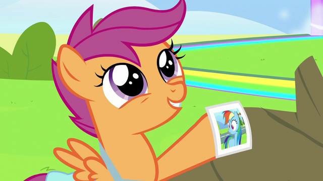 File:Scootaloo holding Rainbow's newest photo S7E7.png