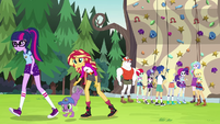 Twilight, Sunset, and Spike leave the rock climbing area EG4