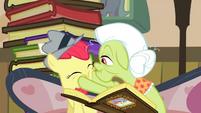 Granny Smith squeezing Apple Bloom's cheeks S2E23