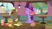 Twilight wiping her face with a hay burger S4E15.png