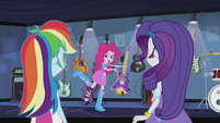 Pinkie Pie holding up a guitar EG2