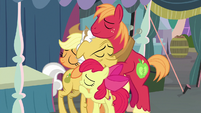Apple siblings hugging their grandfather S7E13