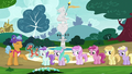 Fillies in line for Twisty Pop's balloon animals S7E6.png