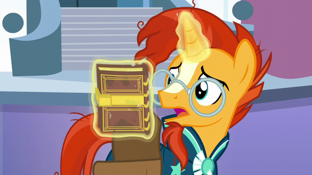 File:Sunburst pulls a book from his saddlebag S6E2.png