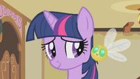 Twilight smiling at her parasprite S1E10
