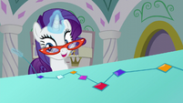 Rarity stitches gems into a Princess Dress S5E14
