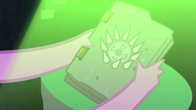 File:Spike takes hold of the book S4E23.png