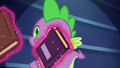 Books being levitated in front of Spike S5E22.png