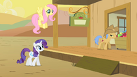 Rarity and Fluttershy approach an Appleloosan S1E21