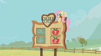 Fluttershy with a rose in her mouth S01E13