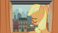 Filly Applejack sighing at Manehattan window S5E25.png