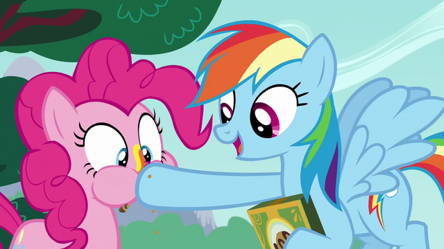 File:Rainbow stuffs another cookie in Pinkie's mouth S6E15.png