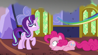 Rainbow Dash zooms out of the castle S6E21
