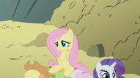 Fluttershy sitting on Applejack and Rarity S1E07