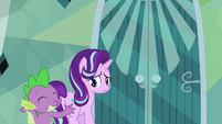 Spike pushes Starlight back toward the door S6E1
