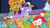 Twilight, Spike, and salespony look at the mess S7E3