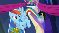 Rainbow Dash dusting a shield S5E3
