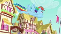 Rainbow Dash flying across Ponyville S6E9