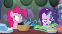 Starlight Glimmer opening the cookbook S6E21