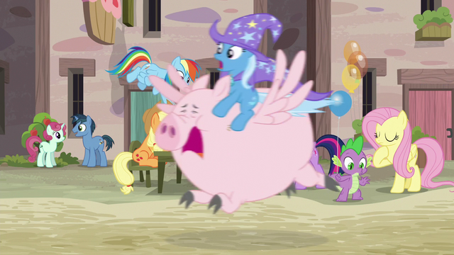 File:Trixie riding through Our Town on a Pigasus S6E26.png