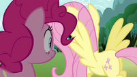 Fluttershy flying over to bush S3E3