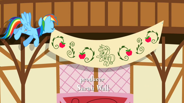 File:Rainbow raising an Applejack banner S2E14.png