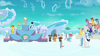 Racing foals being awarded medals and stickers S7E7