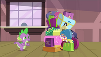 Spike nervously walking towards Rarity's bags S4E8