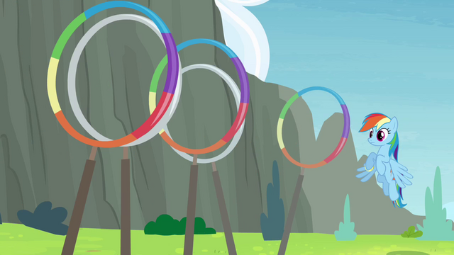 File:Rainbow Dash about to go through the rings S4E10.png