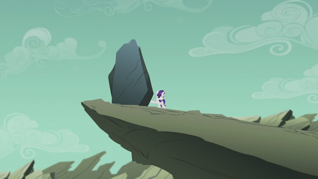 File:Filly Rarity pushing the dumb rock off the cliff S5E25.png