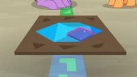 Twilight solving a tangram puzzle S7E2