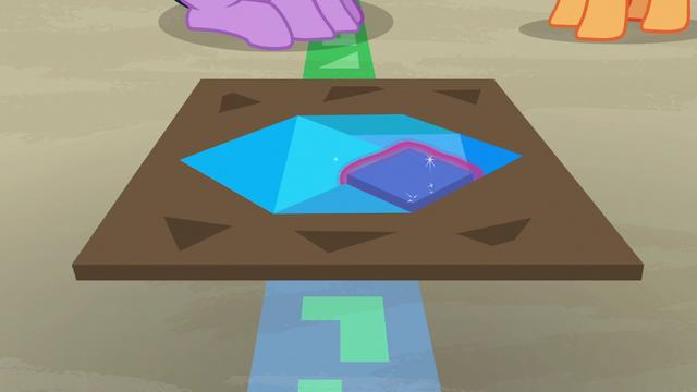 File:Twilight solving a tangram puzzle S7E2.png