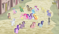 Villagers march in a circle around Mane Six S5E1