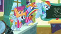 Rainbow and parents fly into the classroom S7E7.png