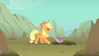 Applejack tries to pull Spike out of a hole S1E19