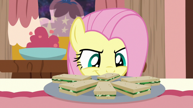 File:Fluttershy looking at cucumber sandwiches S7E12.png
