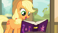 Applejack looking at the journal S4E09.png