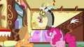 Discord pops out of the counter with a cupcake S5E22.png