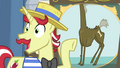Flam pointing at picture showing a tall pony S4E20.png