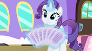 Rarity showing the tickets S4E08.png