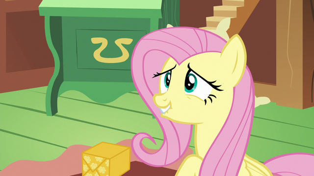 File:Fluttershy looking embarrassed at Discord S6E17.png