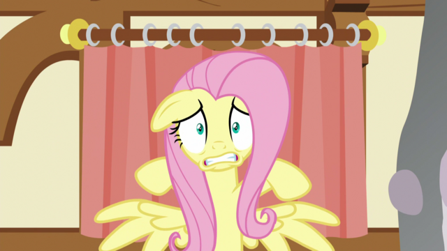 File:Fluttershy scared in front of the curtains S5E21.png